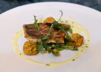 City College Norwich Main - Pan Fried Seabass, Chargrilled Asparagus, Sweet Potato Kofta,Turned Heirloom Carrots, Pea and Watercress Puree and a White Wine Reduction Sauce