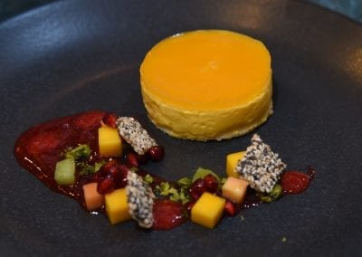 City College Norwich Dessert - Mango Delice, Poppy and Seseme Seed Snap, Rasbperry Coulis, Mango, Passionfruit Jell, Pistachios and a Raspberry Gel