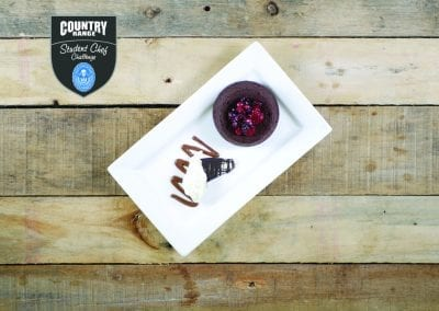 East Kent College Dessert - Cardamom and Chilli Chocolate Brownie, Chantilly cream, forest fruit compote